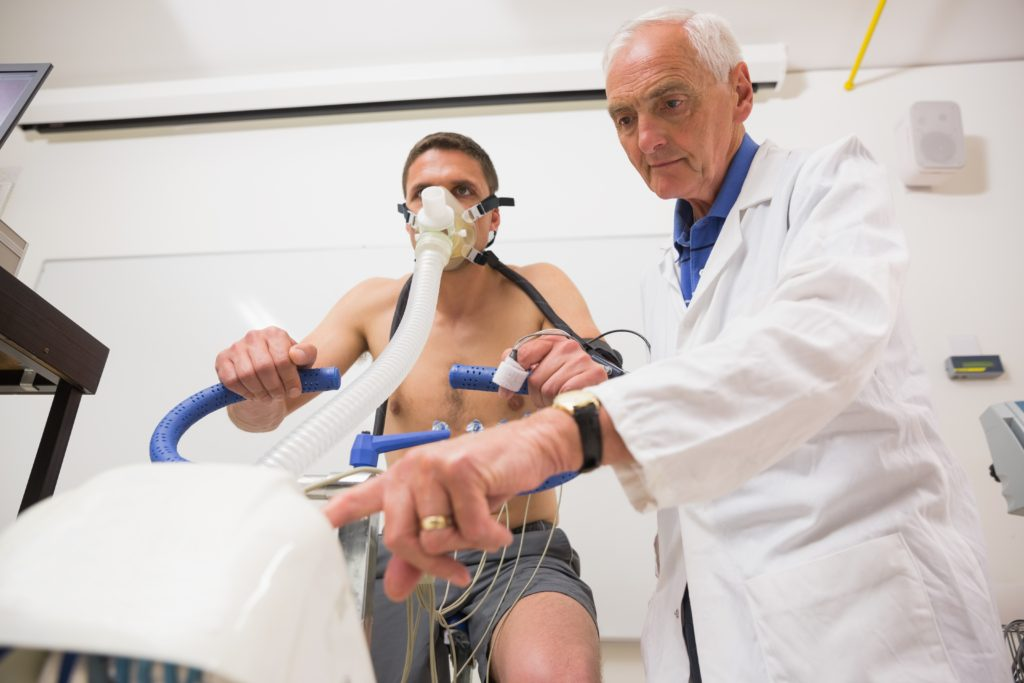 Doctor with man doing fitness test